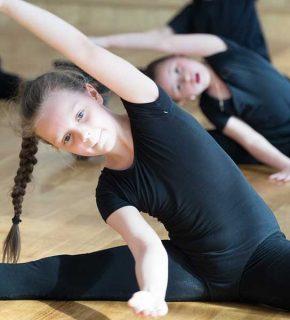 Kids doing gymnastics at home
