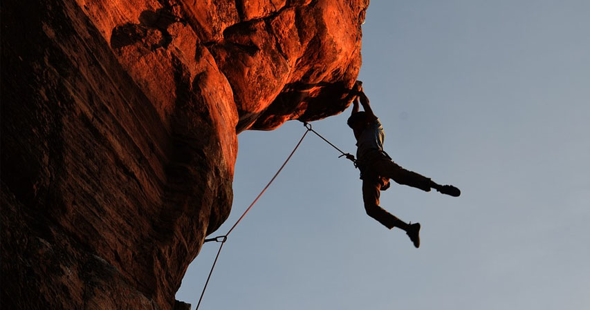 Climber hanging a hundred feet high