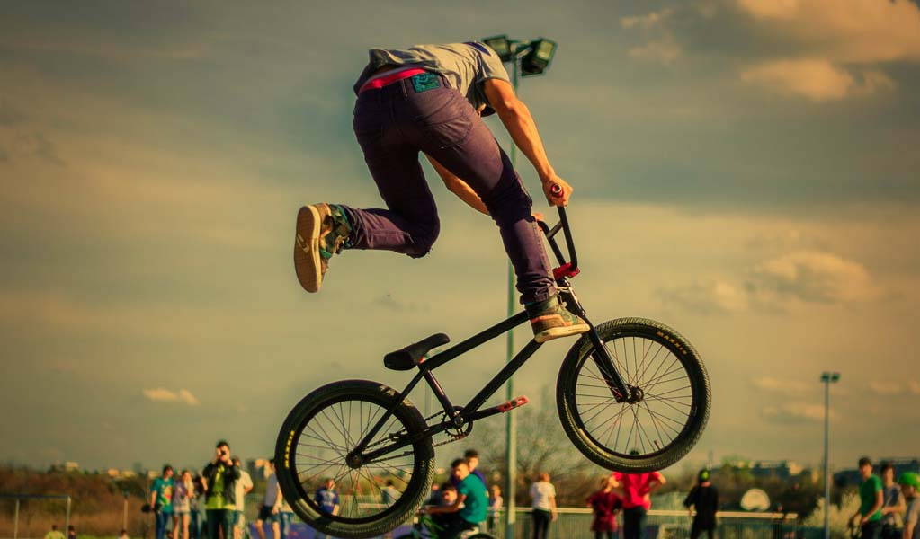 Boy doing Bicycle Stunt
